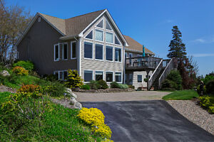 ***NEW PRICE***Stunning Open Concept Home with Ocean Views