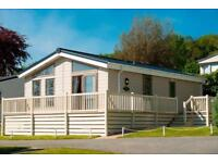 STUNNING LODGE FOR SALE WITH MASSIVE DECKING AND SUNKEN HOT TUB AT TAN RALLT