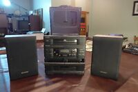 Sharp, 3 disk, 2 caste, AM FM stereo with seekers and remote con