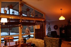 4 season cottage on 50 acres with river