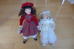 2 Beautiful Porcelain Dolls $15.--/ea.