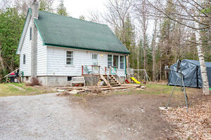 Country 1.5 storey home surrounded by mature trees JESSICA YATES