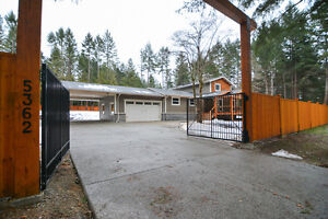 Beautifully renovated home and acreage