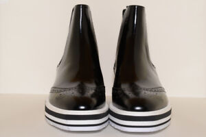 BRAND NEW PRADA WINGED CHELSEA PATENT ANKLES BOOT (AUTHENTIC)