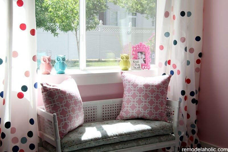 Painting simple white curtains allows you to customise window treatments to your child's space. (Image: Remodelaholic)