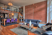 amazing loft for rent October 20 feet ceiling and brick walls