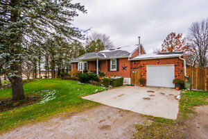 Solid brick bungalow on 2.36 acres within the City limits London Ontario image 1