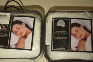 2 new Cotton Classic Mattress Protectors. Size: Twin XL. Never u