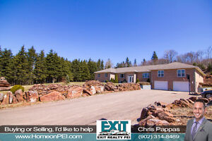 Gorgeous & Spacious brick home in a private wooded area