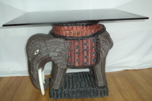 Small Wicker elephant table with thick smoked glass $50