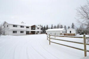 Mature acreage just minutes from Red Deer!