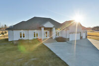 1.13 acres, 5 bed, 4.5 bath, landscaped, fenced w/ city water!