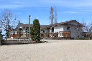 Spacious Bungalow on 3.20 Acres with Shop near Roblin, MB!