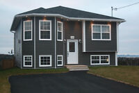 NEW HOME CONSTRUCTION ON 1/2 ACRE LOT IN SEAL COVE