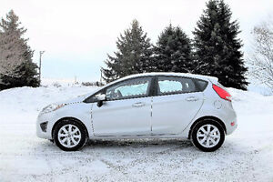 2013 Ford Fiesta SE- Hatchback.  Just 73K!!  4 NEW SNOW TIRES!!
