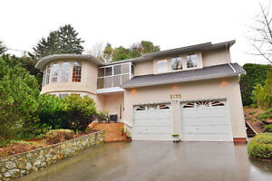 5 Bedrooms + Den/Office & Sunroom. Executive Home