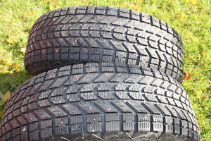 Two Firestone Winterforce UV P235/70R/16 Studded Tires