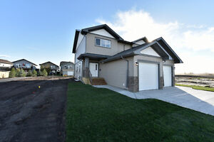 Brand New 2 Storey Duplex with Attached Garage- Income Property