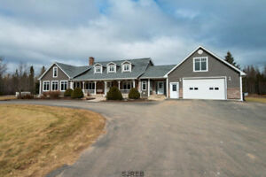 Lovely a executive home with huge 88 x 40 maintenance garage!