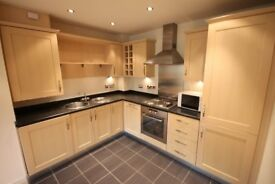 Stylish 2 bedroom apartment in modern development close to York city centre with parking space