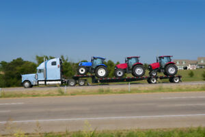 Hauling heavy equipment and farm equipment in Canada and Usa.