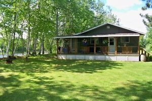 MUST SEE COTTAGE ON THE MAJESTIC TOBIQUE RIVER