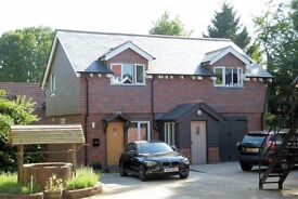 A lovely newly built house, 2 double bedrooms great location in the village of Grayshott.