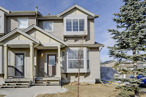 BEAUTIFUL End Unit Airdrie Townhouse Backing onto GREEN SPACE