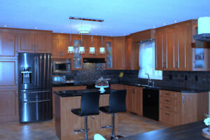 Kitchen cabinets, granite countertops, and two appliances