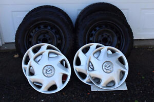"PENDING SALE:  4 Snow tires mounted on  Rims, Mazda 16"" Covers"