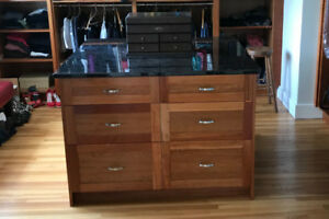 Cherry finish chest of drawers with black granite top