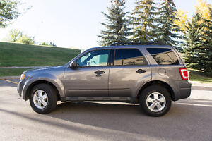 2012 Ford Escape XLT – AWD, 3.0L V6, with winter tires on rims