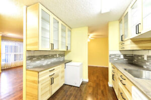 Completely renovated condo in parklike setting w/ a fenced yard!