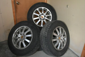 2009 porsche cayenne17in. rims compact  with winter tire.
