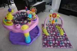 Pink exersaucer and matching play mat