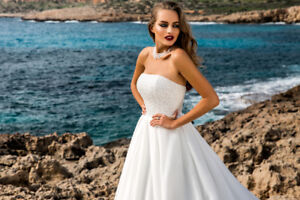 New gorgeous wedding gown with beaded corset and long train (s)