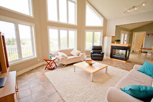 Gorgeous Custom Designed Home with Secondary Suite! Ocean Views!