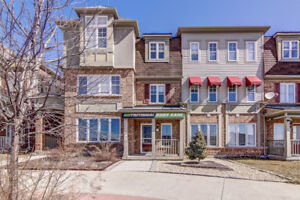 Stunning 3 storey town home with 300 sqft of commecial space!