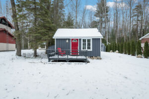 Check out this tiny blue bunkie in Balm Beach!