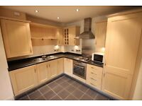 Beautifully presented two bedroom apartment in Olympian Court development with parking space