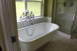 White Claw Foot Tub and Chrome Standing Tub Facet