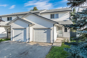 FRESHLY PAINTED 2-Storey Condo with Attached Garage