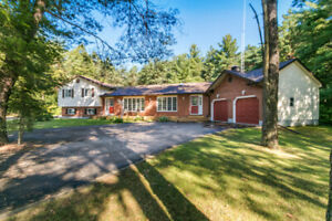 3 + 2 Bedroom home on Private 1 Acre lot!