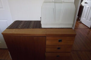 White sewing machine with teak veneer cabinet