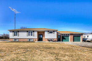 Raised Bungalow Is Located On A 1.98 Acre Lot.