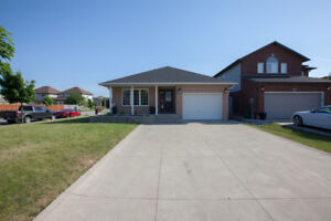 Beautiful brick bungalow with full IN LAW offering over 3000sq f