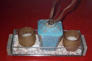 beau vase turquoise avec coquillage et chandelles