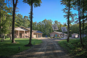 51 ACRE COUNTRY ESTATE W/SOLAR POWER INCOME!