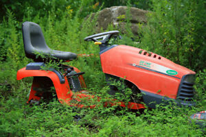 Old unwanted lawn and garden tractors.