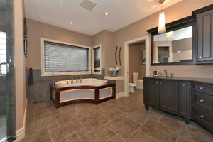 CUSTOM EXECUTIVE PROPERTY BACKING ONTO FORESTED GREEN SPACE! London Ontario image 8